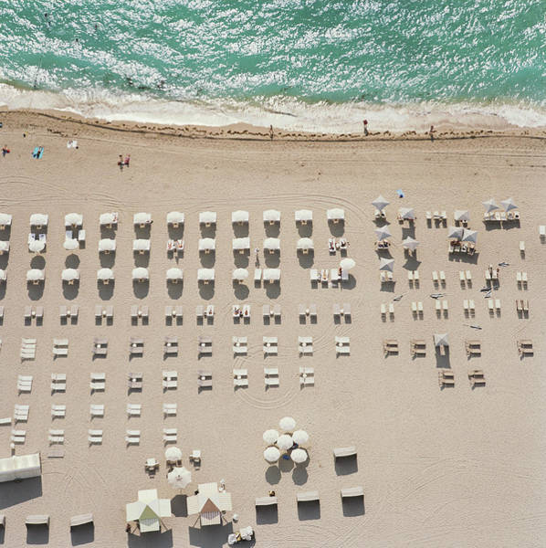 Lounge Chair Photograph - People At Beach, Using Rows Of Beach by John Humble
