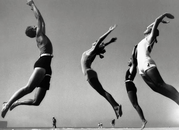 Improvement Photograph - People Exercising On Beach B&w by Hulton Archive