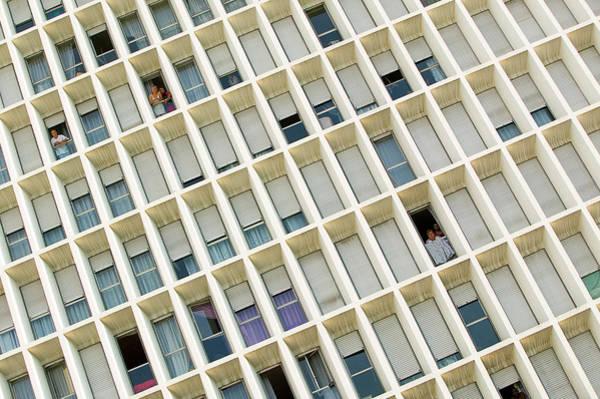 Unusual Perspective Wall Art - Photograph - People Looking Through Windows by Xavier Zimbardo