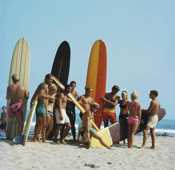 Surfing Photograph - People On Beach With Surf Board by Tom Kelley Archive