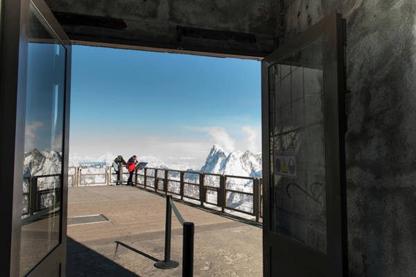 Chalet Photograph - People Peering Over The Edge Of A by Keith Levit / Design Pics