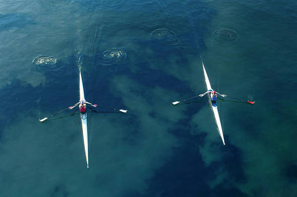 Oar Photograph - People Rowing Sculling Boats On River by Blend Images/pete Saloutos