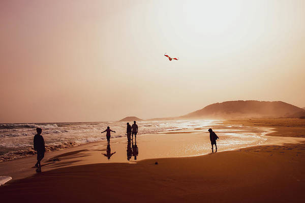 Photograph - People Silhouettes On The Beach 3 by Iordanis Pallikaras