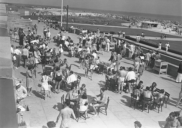 High Water Mark Photograph - People Sitting At Tables By Beach, B&w by George Marks