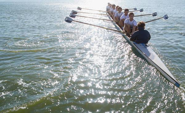 Oar Photograph - People Sitting In A Row Oaring Boat by Clerkenwell