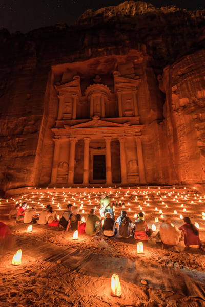 Wall Art - Photograph - People Sitting In Front Of Candles Pharaoh S Treasure House Beaten Into Rock At Night Facade Of The by imageBROKER - Moritz Wolf