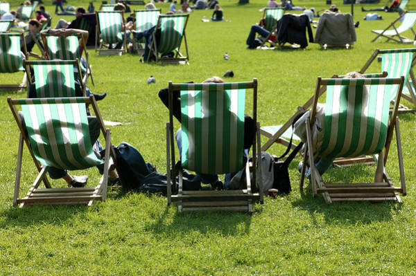 Deck Chair Photograph - People Sunning On Deck Chairs, Hyde by Lonely Planet