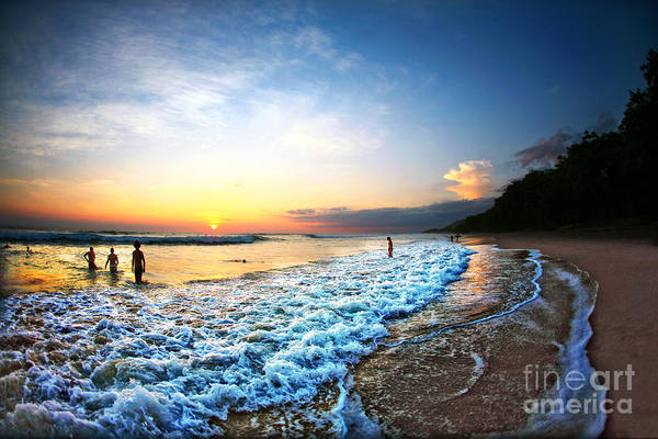 Dusk Wall Art - Photograph - People Swimming In Ocean During Sunset by N K