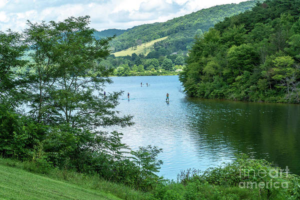Photograph - People Use Stand-up Paddleboards On Lake Habeeb At Rocky Gap Sta by William Kuta