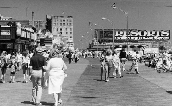 New Jersey Photograph - People Walk Along The Boardwalk In by New York Daily News Archive