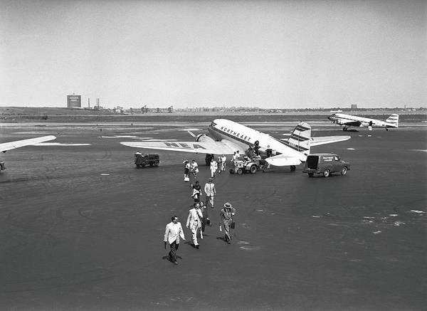 People Walking Photograph - People Walking On Runway, B&w, Elevated by George Marks