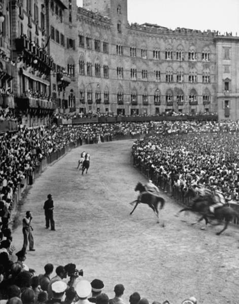 Siena Photograph - People Watching Horse Race That Is Tradi by Walter Sanders