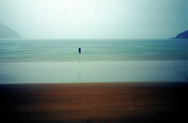 Storm Photograph - Person Standing In Sea During A Storm by Orien Harvey