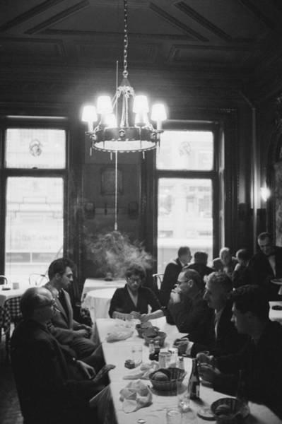 Elliott Photograph - Photographers Luncheon by Slim Aarons