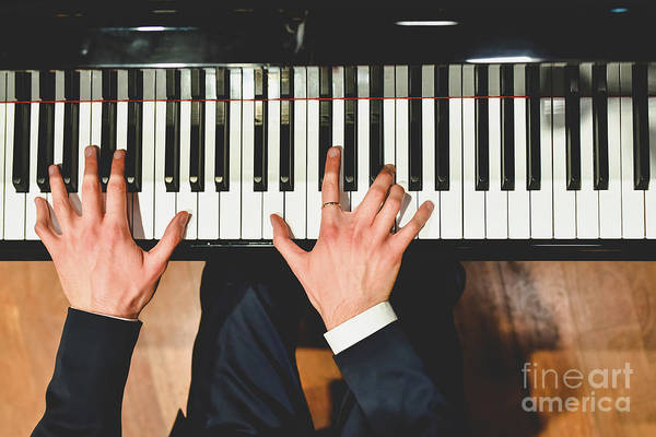 Photograph - Pianist Performing A Piece On A Grand Piano With White And Black Keys., Seen From Above... by Joaquin Corbalan