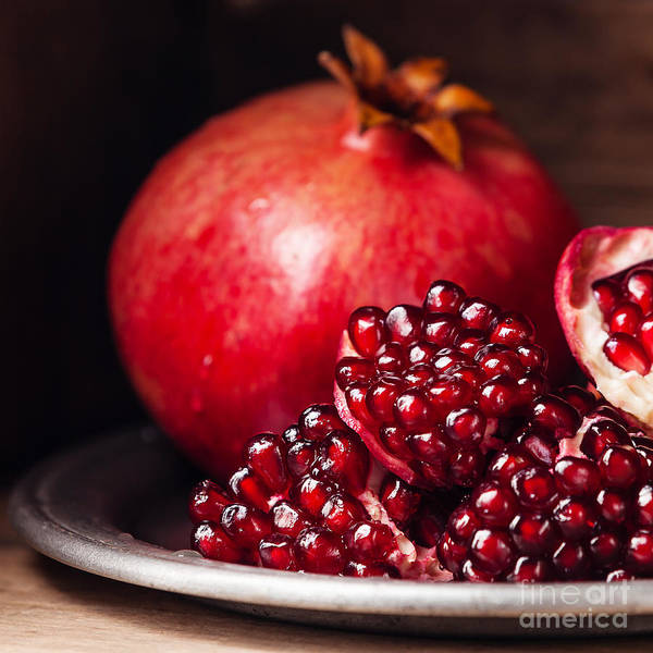 Raw Wall Art - Photograph - Pieces And Seeds Of Ripe Pomegranate by Lisovskaya Natalia