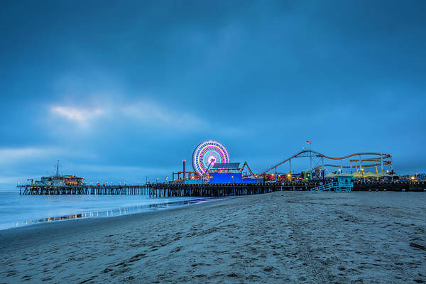 Photograph - Pier With Carnival Rides At Dusk by Bob Stefko