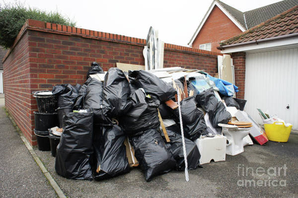 Bin Wall Art - Photograph - Pile Of Household Waste by Tom Gowanlock