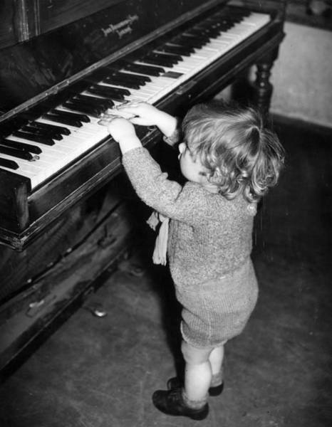 Reach Wall Art - Photograph - Pint Size Pianist by Fred Morley