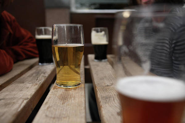 Alcohol Photograph - Pints Of Lager On A Pub Table by John Carey