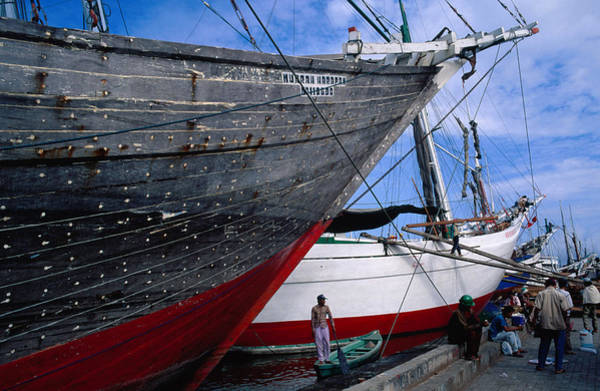 Southeast Asia Wall Art - Photograph - Pisini Schooners Brightly Painted by Glenn Beanland