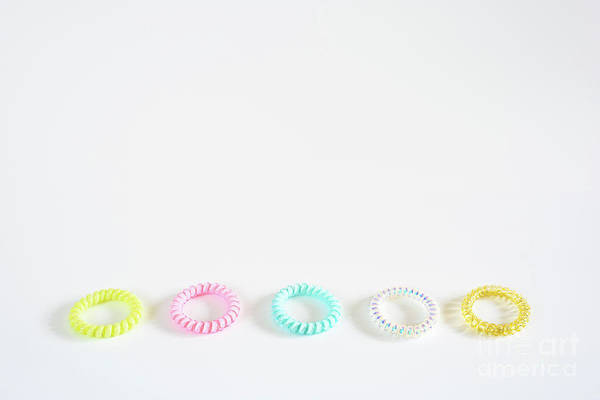 Photograph - Plastic Bracelets Of Various Colors, Isolated In A Pattern Arran by Joaquin Corbalan