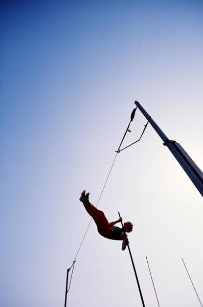 Bar Photograph - Pole Vaulting, Athlete Clearing Bar by Gerard Loucel
