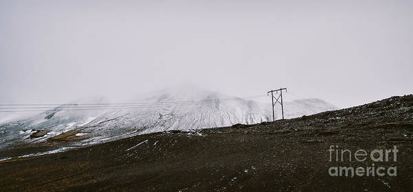 Photograph - Poles Of Electricity In The Middle Of A Snowy Mountain To Supply Electrical Power To Remote Villages. by Joaquin Corbalan
