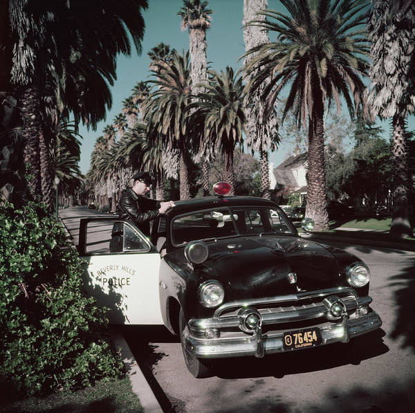 Police Force Photograph - Police Patrolman by Slim Aarons