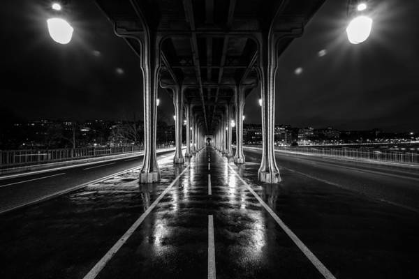 Wall Art - Photograph - Pont De Bir Hakeim Bridge From The Movie Inception Located In Paris, France, Seen On A Rainy Night. by George Afostovremea