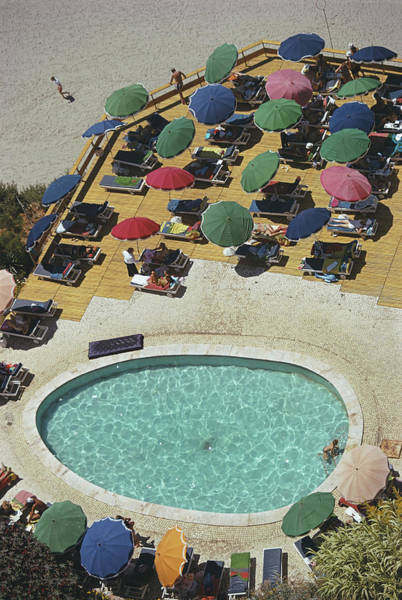 Parasol Photograph - Pool At Carvoeiro by Slim Aarons