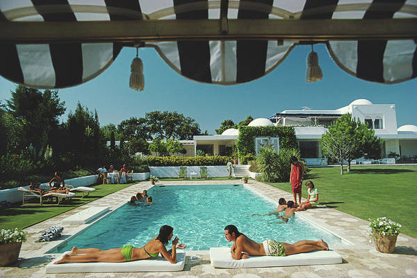 Group Of People Photograph - Poolside In Sotogrande by Slim Aarons