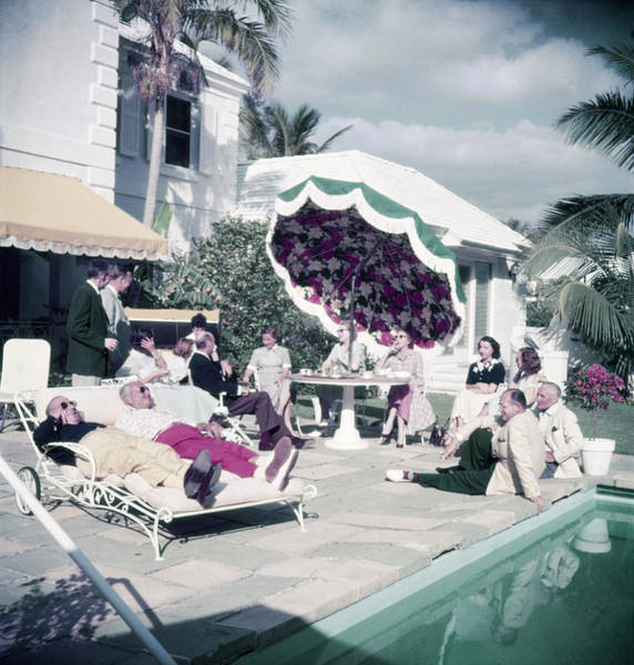 Lounge Chair Photograph - Poolside Party by Slim Aarons