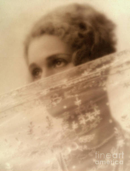 Wall Art - Photograph - Portrait Of A Young Woman With Her Face Partly Covered By A Veil by Italian School