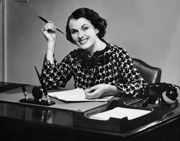 Businesswoman Photograph - Portrait Of Businesswoman At Desk by George Marks