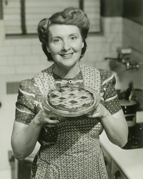 Apron Photograph - Portrait Of Mature Woman Holding Pie by George Marks