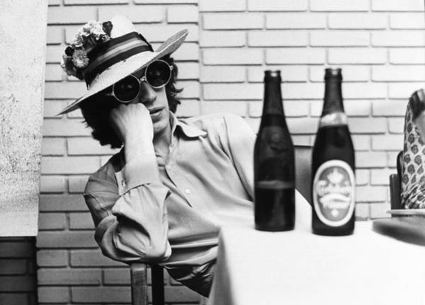 Bottle Photograph - Portrait Of Mick Jagger With A Sun Hat by Keystone-france