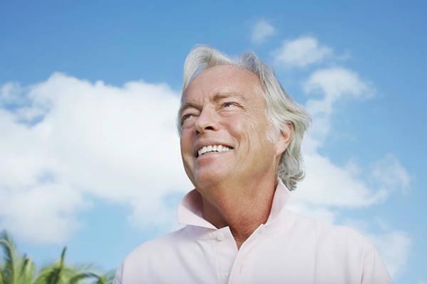 Senior Adult Photograph - Portrait Of Senior Man Against Sky by Moodboard