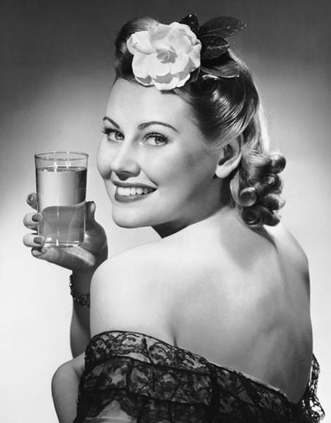 Drinking Glass Photograph - Portrait Of Woman Holding Glass Of Water by George Marks