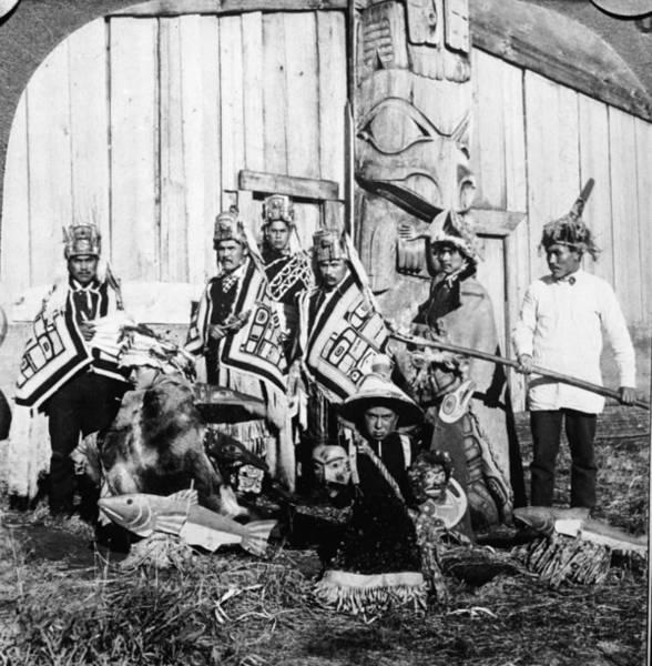 Totem Pole Wall Art - Photograph - Potlatch Dancers In Klinkwan by Hulton Archive