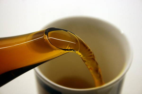 Teapot Photograph - Pouring Tea by Bob  Balmer Images