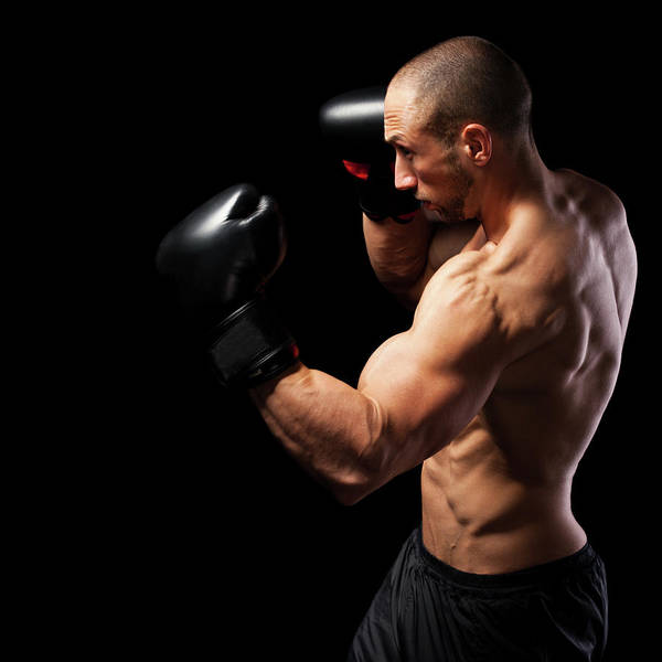 Shaved Head Photograph - Powerful Punch by Momcilog