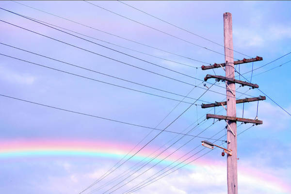Electricity Generation Photograph - Powerlines Against Rainbow Sky by Nikki Yetman