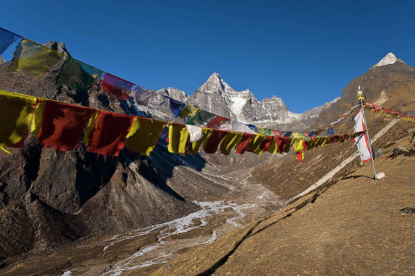 Hanging Rock Photograph - Prayer Flags On Dusty Mountainside by Cultura Exclusive/ben Pipe Photography