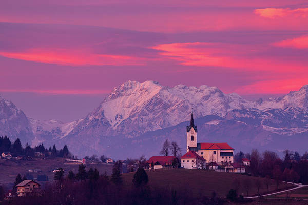Wall Art - Photograph - Prezganje Church With Snowy Kamnik Alps At Sunset by Ian Middleton