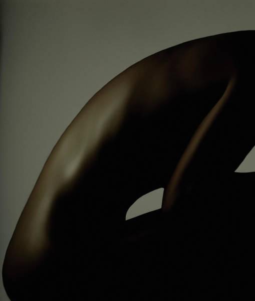 Bending Photograph - Profile Of Womans Nude Torso Bending by Jupiterimages