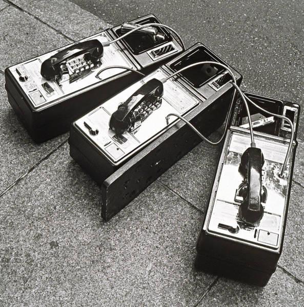 Telephone Photograph - Public Phones Lying On Sidewalk by Henri Silberman