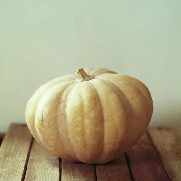 Wood Photograph - Pumpkin On Wooden Table by Copyright Anna Nemoy(xaomena)