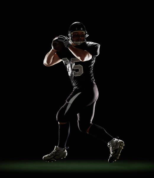 Football Helmet Photograph - Quarterback In Three-step Drop Position by Lewis Mulatero