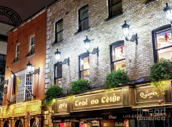 Wall Art - Photograph - Quays Bar At Night In Dublin by John Rizzuto